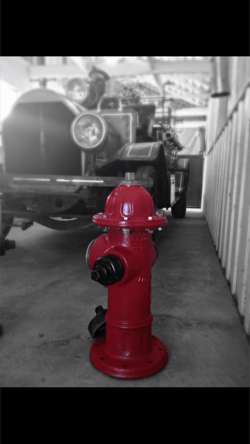 Fire Hydrant Next to Old Fire Truck