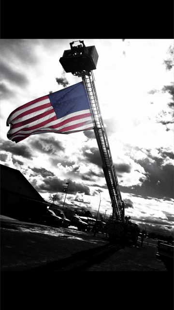 Fire Truck With Crane Up and American Flag Flying