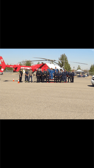 Group of Firefighters Standing Next to a Helicopter